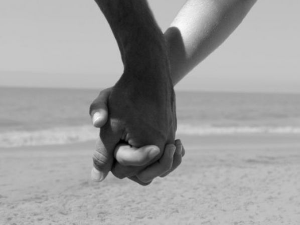 A Black and White Cartoon of a Couple Holding Hands - Royalty Free Clipart
