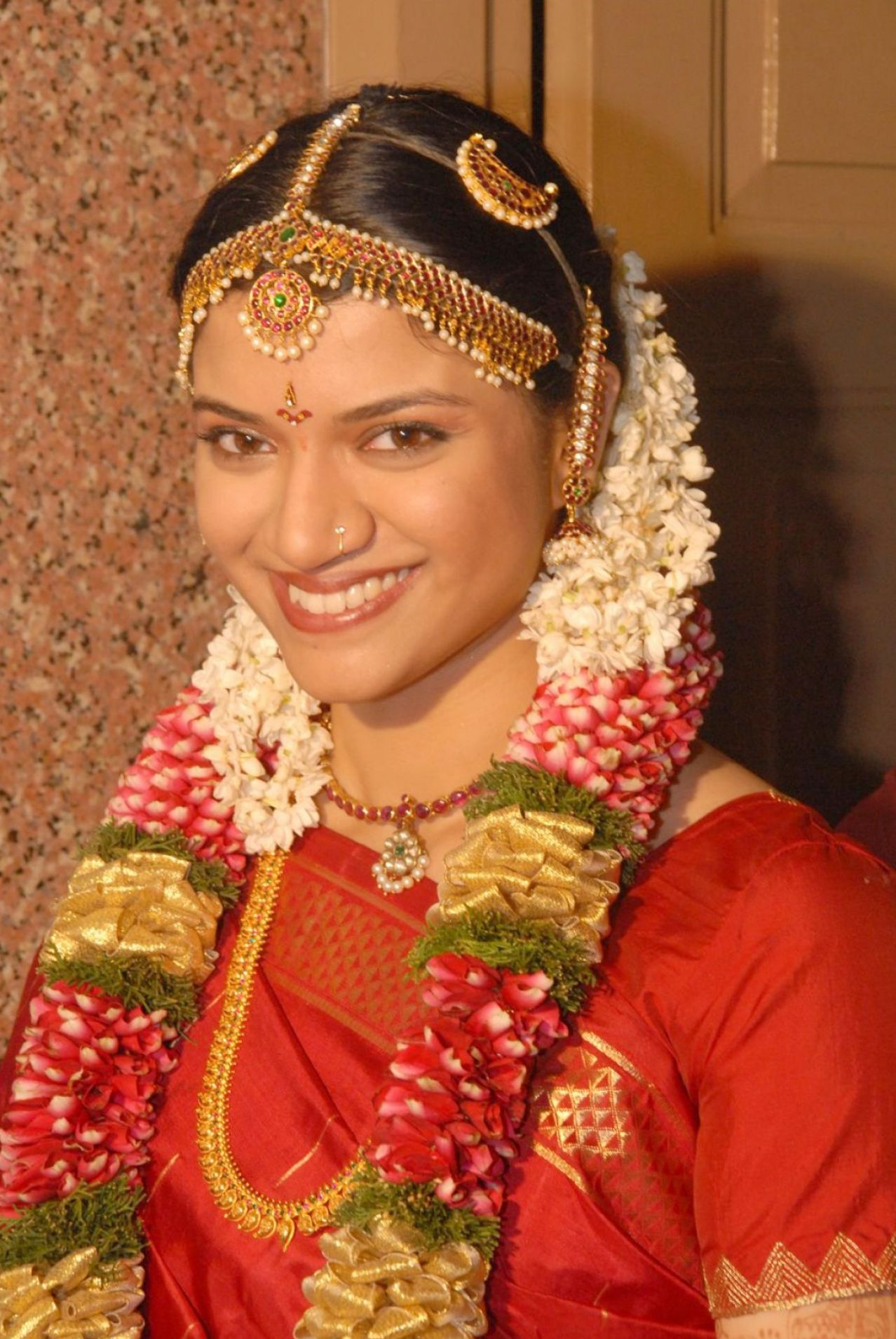 south indian bridal hairstyles for reception 4